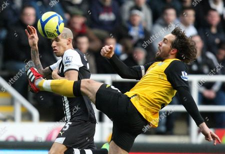 Newcastle United's Gabriel Obewrtan, left, vies for the ball with Blackburn Rovers' captain Gael Givet during their English FA Cup third round soccer match at the Sports Direct Arena, Newcastle, England