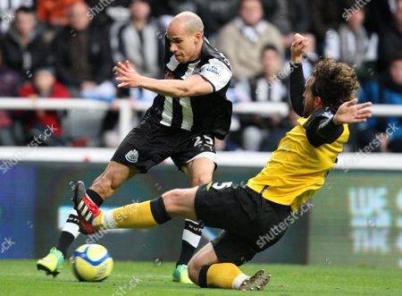 Newcastle United's Gabriel Obertan, left, has a shot on goal past Blackburn's captain Gael Givet, right, during their FA Cup third round soccer match at the Sports Direct Arena, Newcastle, England