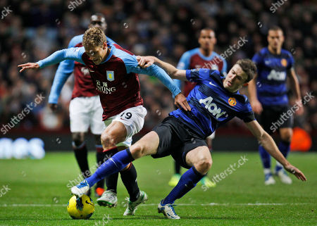 Stock Picture of Manchester United's Michael Garrick, right, tries to stop Aston Villa's Stiliyan Petrov, left, during their English Premier League soccer match at Villa Park ground in Birmingham, England, . Manchester United won the match 1-0