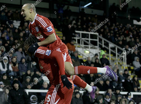 West Bromwich Albion's Somen Tchoyi, left, celebrates his goal with Peter Odemwingie during the English Premier League soccer match between Fulham and West Bromwich Albion at Craven Cottage stadium in London