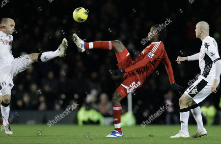 Stock Photo of Fulham's Danny Murphy, left, and Philippe Senderos, right, competes for the ball with West Bromwich Albion's Somen Tchoyi during the English Premier League soccer match between Fulham and West Bromwich Albion at Craven Cottage stadium in London
