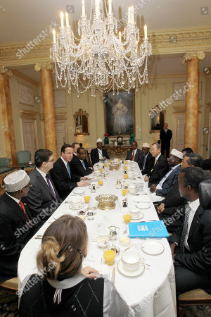 Stock Picture of British Prime Minister David Cameron, third left, leads a breakfast meeting with representatives of Somalia and the UN at 10 Downing Street in London before the Somalia Conference, . People are, from left, Speaker of Transitional Federal Government (TFG), Hassan Sheikh Aden Issak, Deputy National Security Council, Oliver Robbins, David Cameron, Prime Minister of TFG, Abdiweli Mohamed Ali, British Ambassador to Somalia, Matt Baugh, Ahlu Sunna Wal Jamah (ASWJ) representative Hersi Mohamed Hilowle, President of Puntland, Abdirahman Mohamed Farole, President of Galmadug, Mohamed Ahmed Alin, UN Secretary-Genaral Ban Ki-Moon, President of TFG, Sharif Sheikh Ahmed, Chair of the Africa Union Commission and President of Puntland Abdirahman Mohamed Mohamud