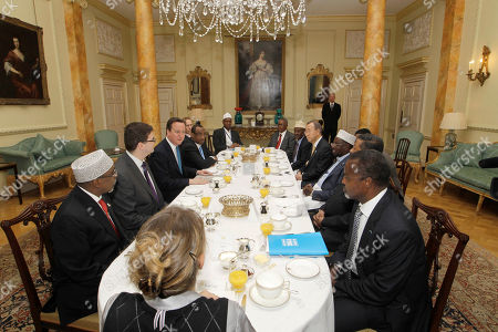 Stock Image of British Prime Minister David Cameron, third left, leads a breakfast meeting with representatives of Somalia and the UN at 10 Downing Street in London before the Somalia Conference, . People are, from left, Speaker of Transitional Federal Government (TFG), Hassan Sheikh Aden Issak, Deputy National Security Council, Oliver Robbins, David Cameron, Prime Minister of TFG, Abdiweli Mohamed Ali, British Ambassador to Somalia, Matt Baugh, Ahlu Sunna Wal Jamah (ASWJ) representative Hersi Mohamed Hilowle, President of Puntland, Abdirahman Mohamed Farole, President of Galmadug, Mohamed Ahmed Alin, UN Secretary-Genaral Ban Ki-Moon, President of TFG, Sharif Sheikh Ahmed, Chair of the Africa Union Commission and President of Puntland Abdirahman Mohamed Mohamud