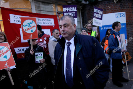 Brendan Barber the General Secretary of Britain's Trades Union Congress (TUC) visits a picket line outside St Pancras Hospital in London, . U.K. border staff joined teachers, hospital workers and weather forecasters Wednesday in Britain's largest strike in decades, but arriving airline passengers appeared to escape the chaos that had been predicted