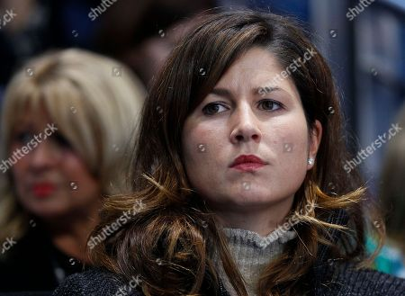 Mirka Vavrinec, wife of Roger Federer of Switzerland, watches her husband warm up as he gets ready to play Rafael Nadal of Spain in their round robin singles match at the ATP World Tour Finals, at the O2 arena in London