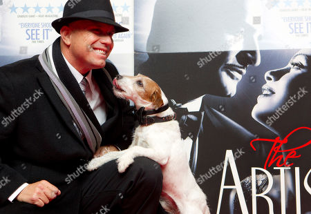 Uggie, Omar Von Muller Uggie the dog who starred in the film The Artist, and was awarded the Palm Dog at the 2011 Cannes Film Festival, attends a special screening at a London cinema with trainer Omar Von Muller