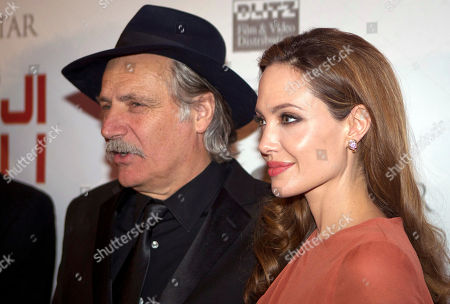 """Angelina Jolie, Rade Serbedzija U.S. actress and director Angelina Jolie, right, and Croatian born actor Rade Serbedzija pose for photographers as they arrive for the screening of her movie """"In The Land of Blood and Honey"""", in Zagreb, Croatia"""