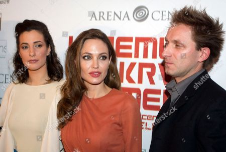 "Angelina Jolie, Zana Maranovic, Goran Kostic U.S. actress and director Angelina Jolie, center, Zana Maranovic, left and Goran Kostic pose for photographers as they arrive for the screening of Jolie's movie ""In The Land of Blood and Honey"", in Zagreb, Croatia"