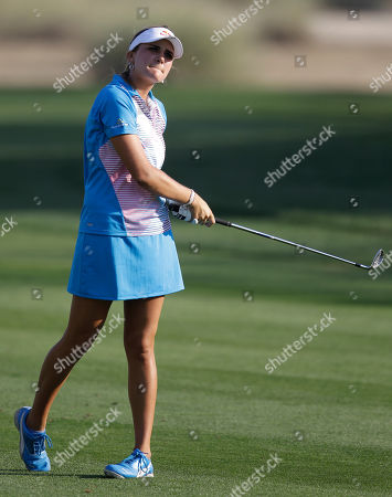 Alexis Thompson Alexis Thompson from U.S. follows her shot on the 16th hole during final day of the Dubai Ladies Masters golf tournament in Dubai, United Arab Emirates
