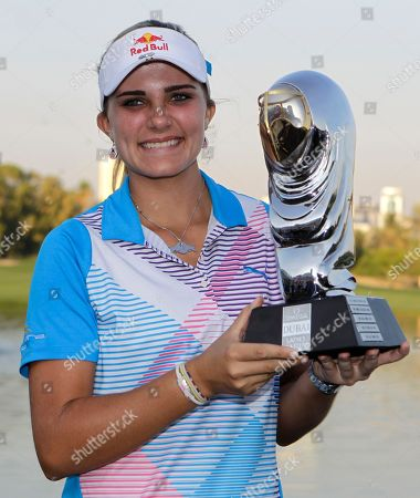 Alexis Thompson Alexis Thompson from the U.S. poses with the trophy after winning the Dubai Ladies Masters golf tournament in Dubai, United Arab Emirates