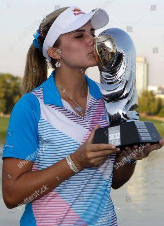 Alexis Thompson Alexis Thompson from the U.S. kisses the trophy after winning the Dubai Ladies Masters golf tournament in Dubai, United Arab Emirates