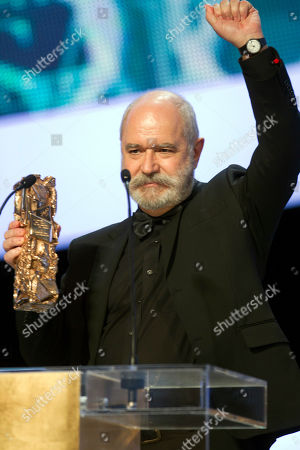"""Stock Image of Christian Rouaud French director Christian Rouaud holds his trophy after receiving the Cesar of the Best Documentary Feature award for """"Tous au Larzac"""" (All in the Larzac) during the 37th French Cesar Awards ceremony at the Theatre du Chatelet in Paris"""