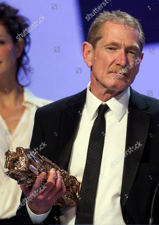 "Production designer Laurence Bennett poses after winning the Best Production Design award for French director Michel Hazanavicius' film ""The Artist"" t during the 37th Cesar Film Awards at Theatre du Chatelet on"
