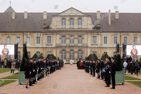 The coffin of former French President Francois Mitterrand's wife Danielle, center back, is seen during her funeral at Cluny cemetery, central France, . Mitterrand, a decorated member of the French Resistance and combative advocate for the poor who broke the mold alongside France's first Socialist president Francois Mitterrand, died Tuesday, Nov. 22 at age 87