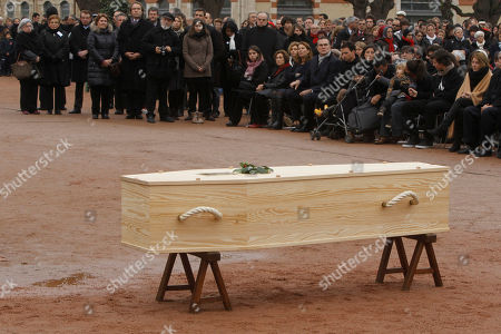 People stand near the coffin of former French President Francois Mitterrand's wife Danielle during her funeral at Cluny cemetery, central France, . Mitterrand, a decorated member of the French Resistance and combative advocate for the poor who broke the mold alongside France's first Socialist president Francois Mitterrand, died Tuesday, Nov. 22 at age 87