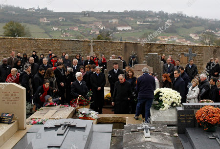 French Culture Minister Frederic Mitterrand, center, pays his respects to former French President Francois Mitterrand's wife Danielle, during her funeral at Cluny cemetery, central France, . Mitterrand, a decorated member of the French Resistance and combative advocate for the poor who broke the mold alongside France's first Socialist president Francois Mitterrand, died Tuesday, Nov. 22 at age 87