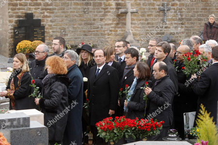 French Socialist Party candidate for the 2012 presidential elections Francois Hollande, center, attends the funeral of former French President Francois Mitterrand's wife Danielle at Cluny cemetery, central France, . Mitterrand, a decorated member of the French Resistance and combative advocate for the poor who broke the mold alongside France's first Socialist president Francois Mitterrand, died Tuesday, Nov. 22 at age 87