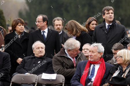 French Socialist Party candidate for the 2012 presidential elections Francois Hollande, top second left, is seen with Socialist Party leader Martine Aubry, top left, and Arnaud Montebourg, top right, during the former French First Lady Danielle Mitterrand's funeral at the Cluny's cemetery, central France, . Mitterrand, a decorated member of the French Resistance and combative advocate for the poor who broke the mold as first lady alongside France's first Socialist president Francois Mitterrand, died Tuesday at age 87