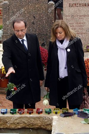 Francois Hollande, Valerie Trierweiler French Socialist Party candidate for the 2012 presidential elections Francois Hollande, left, throws a rose on the French First Lady Danielle Mitterrand's coffin as he attends her funeral with his partner Valerie Trierweiler, right, at the Cluny's cemetery, central France, . Mitterrand, a decorated member of the French Resistance and combative advocate for the poor who broke the mold as first lady alongside France's first Socialist president Francois Mitterrand, died Tuesday at age 87