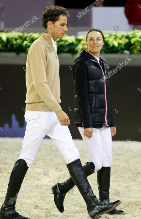 Martina Hingis, Thibault Hutin Former Tennis player Martina Hingis of Switzerland, left, and her husband Thibault Hutin walk to check the fences prior to the Gucci Paris Masters show jumping event at Villepinte, north of Paris