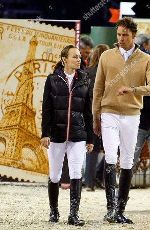Stock Image of Martina Hingis, Thibault Hutin Former Tennis player Martina Hingis of Switzerland, left, and her husband Thibault Hutin walk to check the fences prior to the Gucci Paris Masters show jumping event at Villepinte, north of Paris