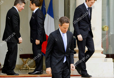 Timothy Geithner, Charles H. Rivkin, Nicolas Sarkozy, Francois Baroin U.S. Treasury Secretary Timothy Geithner, center, leaves following his meeting at the Elysee Palace with French President Nicolas Sarkozy, second left, and French Finance Minister Francois Baroin, right, in Paris, . Geithner said Wednesday he is very encouraged with the progress Europe is making in coming up with a plan to shore up the euro in the wake of a crippling debt crisis
