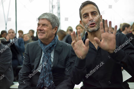 Yves Carcelle, Marc Jacobs U.S fashion designer Marc Jacobs, right, gestures as Louis Vuitton's chairman and CEO Yves Carcelle, left, smiles prior to Louis Vuitton Men's fall-winter 2012-2013 collection, presented in Paris