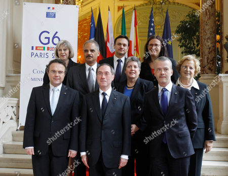 Hans Peter Friedrich, Claude Gueant, Antonio Camacho, Eric Holder, Janet Napolitano, Anna Maria Cancellieri, Theresa May, Jacek Cichocki, Cecilia Malmstrom Interior ministers gather for a group photograph during a G6 meeting at the Interior ministry in Paris, . From left first row: Germany's Hans Peter Friedrich, France' Claude Gueant, Spain's Antonio Camacho, second row: US Attorney General Eric Holder, US Secretary of Homeland Security Janet Napolitano, Italy's Anna-Maria Cancellieri, third row: Britain's Theresa May, Poland's Jacek Cichocki, and EU commissioner Cecilia Malmstrom