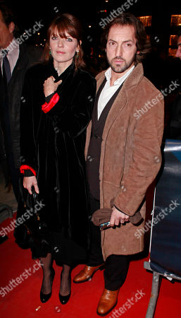 French actors Frederic Dienfenthal and Gwendoline Hamon arrive to the Globe de Cristal awards 2011, at the Lido cabaret, in Paris