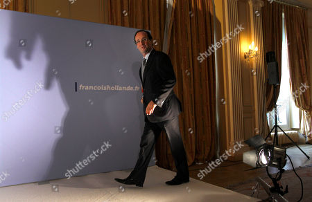 French Socialist Party candidate for the 2012 presidential elections Francois Hollande arrives to deliver a speech to pay hommage to Danielle Mitterrand, in Paris, . Mitterrand, a decorated member of the French Resistance and combative advocate for the poor who broke the mold as first lady alongside France's first Socialist president, Francois Mitterrand, died Tuesday at age 87