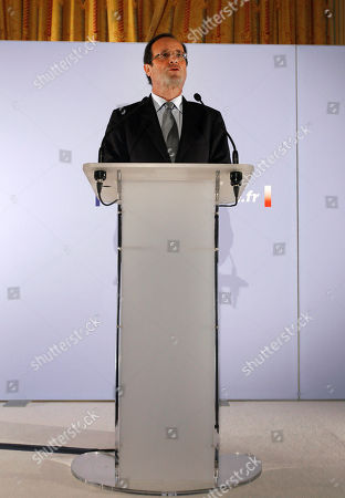 French Socialist Party candidate for the 2012 presidential elections Francois Hollande delivers a speech to pay hommage to Danielle Mitterrand, in Paris, . Mitterrand, a decorated member of the French Resistance and combative advocate for the poor who broke the mold as first lady alongside France's first Socialist president, Francois Mitterrand, died Tuesday at age 87