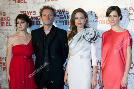 "Stock Picture of U.S. actress and director Angelina Jolie, second from right, Goran Kostic, second from left, Zana Maranovic, right, and Vanesa Glodjo, left, arrive for the screening of the movie ""In The Land of Blood and Honey"", in Paris"