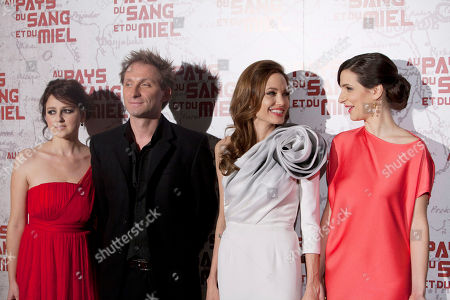 "U.S. actress and director Angelina Jolie, second from right, Goran Kostic, second from left, Zana Maranovic, right, and Vanesa Glodjo, left, arrive for the screening of the movie ""In The Land of Blood and Honey"", in Paris"