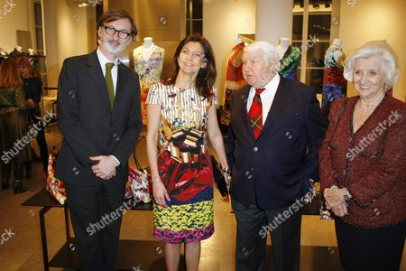 Stock Image of Jean Cassegrain, Sophie Delafontaine, Philippe Cassegrain From left, French Longchamp CEO Jean Cassegrain, French artistic director Sophie Delafontaine, French Longchamp chairman Philippe Cassegrain and his wife pose at a Longchamp cocktail party as part of the Haute Couture Fashion Week in Paris