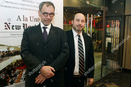 "David Carr, Andrew Rossi New York Times journalist David Carr, left, and director Andrew Rossi, right, pose for photographs as they arrive for the French premiere of the documentary ""Page One: A Year Inside The New York Times,"" in Paris"