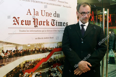 "David Carr, Andrew Rossi New York Times journalist David Carr poses for a photograph as he arrives for the French premiere of the documentary ""Page One: A Year Inside The New York Times,"" in Paris"
