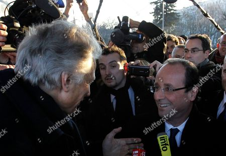 French Socialist Party candidate for the 2012 presidential elections Francois Hollande, right, speaks with former French Prime Minister Dominique de Villepin, who is a candidate for presidential elections, at the Dijon station, central France