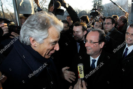 French Socialist Party candidate for the 2012 presidential elections Francois Hollande, center right, speaks with former French Prime Minister Dominique de Villepin, who is a candidate for presidential elections, at the Dijon station, central France
