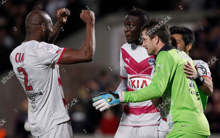 Michael Ciani, Ludovic Sane, Cedric Carrasso Bordeaux's Michael Ciani, left, Ludovic Sane, center, and Bordeaux's goalkeeper Cedric Carrasso, right, react after winning 1-0 against Lyon during the French League one soccer match in Bordeaux, southwestern France