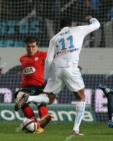 Cedric Carrasso, Loic Remy Bordeaux French goalkepper Cedric Carrasso, left, challenges for the ball with Marseille's French forward Loic Remy, during their French League One soccer match, at the Velodrome Stadium, in Marseille, southern France