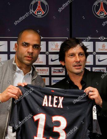 Alex Rodrigo Da Dias Costa Paris Saint-Germain soccer director Leonardo, right, presents newly signed player Alex from Brazil, left, following a news conference at the Parc des Princes stadium in Paris