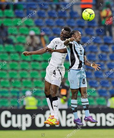 Ghana's John Pantsil, left, defends against Botswana's Phenyo Mongala, right, during their African Cup of Nations Group D soccer match at the Stade de Franceville in Franceville, Gabon