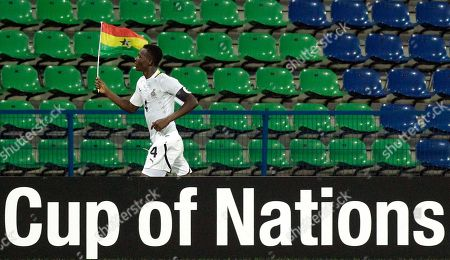 Ghana's John Pantsil runs with his national flag after winning their African Cup of Nations Group D soccer match against Botswana at the Stade de Franceville in Franceville, Gabon