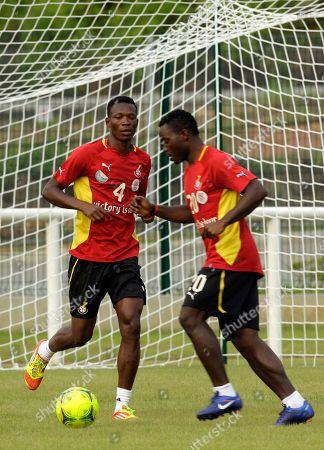 Ghana's soccer player John Pantsil, left, with teammate Kwadwo Asamoah, right, during their training in Ngouoni, 45km outside Franceville, Gabon, . Ghana will play their African Cup of Nations Group D soccer match against Mali on Saturday Jan. 28, 2012