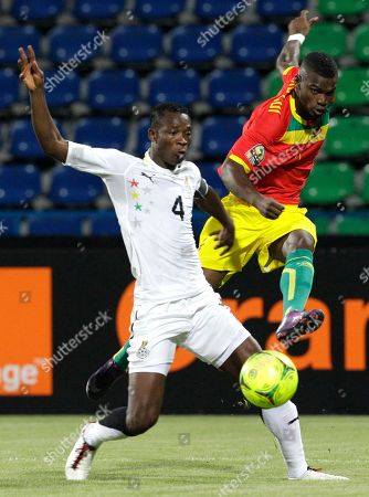 Guinea's Abdoul Razzagui Camara, right, kicks as Ghana's captain John Pantsil, left, defends during their African Cup of Nations Group D soccer match at the Stade de Franceville in Franceville, Gabon, . Ghana and Guinea played a 1-1 draw