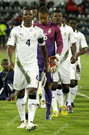 Ghana's captain John Pantsil, left, leads teammates into the field during their African Cup of Nations Group D soccer match against Guinea at the Stade de Franceville in Franceville, Gabon
