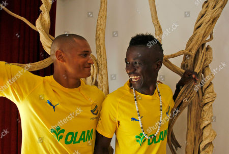Daniel Cousin, Eric Kouloungui Gabon soccer captain Daniel Cousin, left, and Eric Kouloungui playing in Nice France, share a laugh during a press conference prior to a training session ahead of their African Cup of Nations Group C soccer match in Libreville, Gabon, on the eve of their match against Niger at Stade De L'Amitie Stadium in Libreville