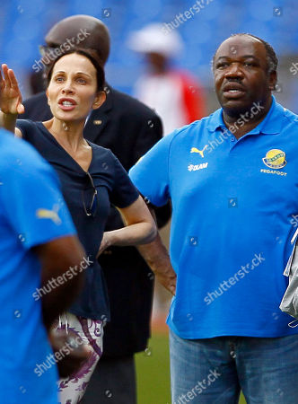 Ali Bongo Ondimba, Sylvia Najma Bongo Gabon President Ali Bongo Ondimba, right, flanked with his wife Sylvia Najma Bongo as the Gabon soccer team during a training session ahead of their African Cup of Nations Group C soccer match in Libreville, Gabon, on the eve of their match against Niger at Stade De L'Amitie Stadium in Libreville