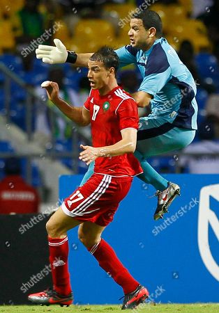 Marouane Chamakh, Aymen Mathlouthi Morocco's Marouane Chamakh, left, is challenged by Tunisia goalkeeper Aymen Mathlouthi during their African Cup of Nations Group C soccer match at Stade De L'Amitie in Libreville, Gabon