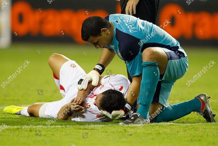 Aymen Mathlouthi, Ammar Jemal Tunisia's goalkeeper Aymen Mathlouthi. right, comforts fellow team member Ammar Jemal during their African Cup of Nations Group C soccer match at Stade De L'Amitie in Libreville, Gabon